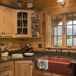 Kitchen, Wooden Cabinet With Black Knob, Black Marble Kithen Top, Red Apron Sink, Sconces, Wooden Ceiling
