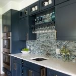 Kitchen, Wooden Floor, Blue Cabinet, White Top, Blue Mosaic Tiles For Backsplash, Dark Upper Cabinet, White Wall