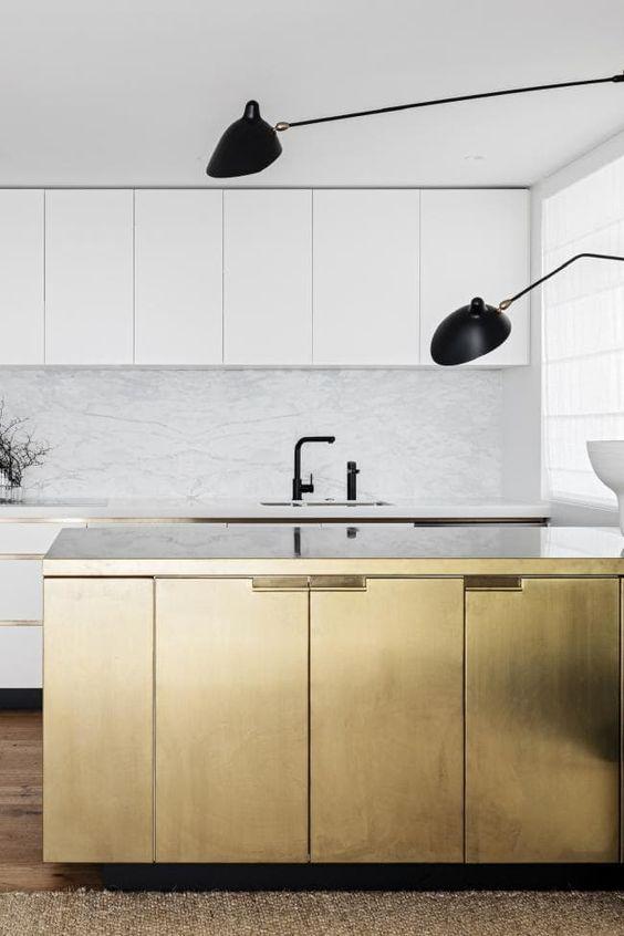 kitchen, wooden floor, brown rug, white marble backsplash, golden island, white cabinet, black long sonces