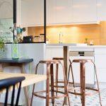 Kitchen, Wooden Floor, Pattern Floor Tiles, White Cabinet, Golden Backsplash, White Pendants, Glas Partition, Wooden Table