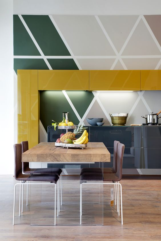 kitchen, wooden floor, patterned wall tiles, yellow gloss upper cabinet, grey bottom cabinet, wooden table, brown chairs