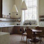 Kitchen, Wooden Floor, Rattan Rug, White Wall, Wooden Bottom Cabinet With White Top, White Wall, Wooden Floating Shelves, White Pendants, Wooden Dining Set