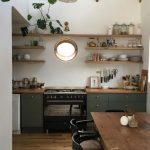 Kitchen, Wooden Floor, Rug, Wooden Table, Black Wooden Chairs, Whtie Wall, Green Bottom Cabinet, Wooden Floating Shevles, Pendant