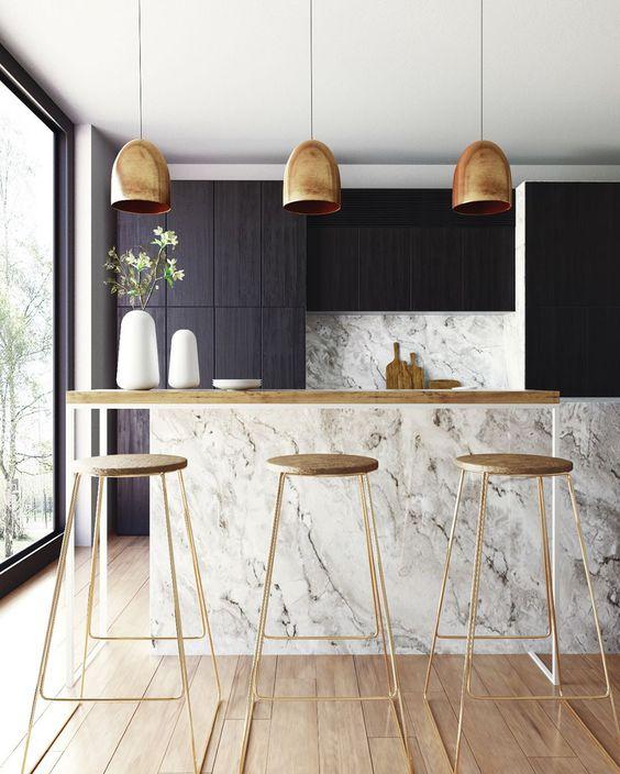 kitchen, wooden floor, white marble backsplash, white marble island, black cabinet, golden pendants, wooden top, wooden stool