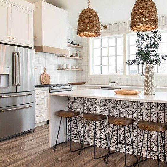 kitchen, wooden floor, white square wall tiles, white hood, white botom cabinet, floating shelves, white paterned island with white top