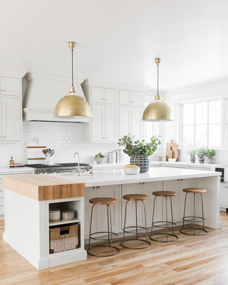 kitchen, wooden floor, white upper cabinet, white backsplash tiles, white wooden island, wooden stool, golden pendant