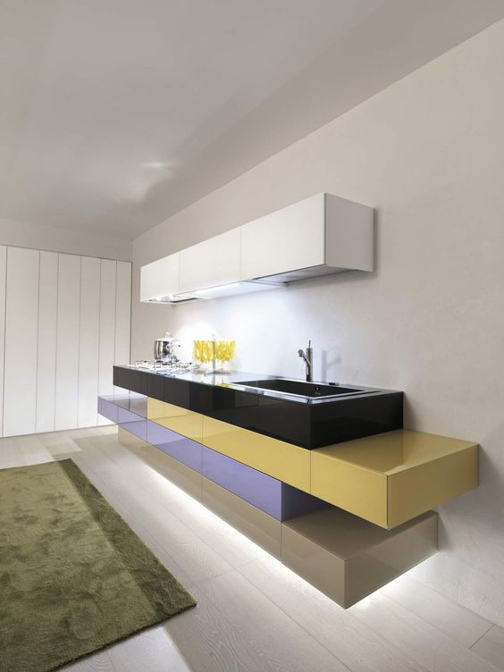kitchen, wooden floor, white wall, white upper cabinet, colorful glossy boards with metal kitchen top