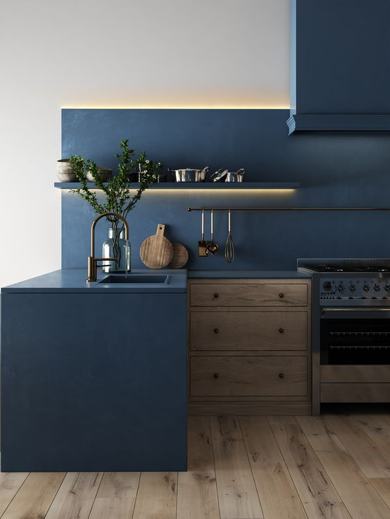 kitchen, wooden floor, wooden cabinet with blue side and top, blue backsplash with floating shelves and LED lights, white wall