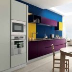 Kitchen, Wooden Floor, Wooden Dining Table Set, Blue Kitchen Wall, Yellow Sink Wall, Purple Floating Shelves, Yellow Floating Cabinet, Purple Bottom Cabinet