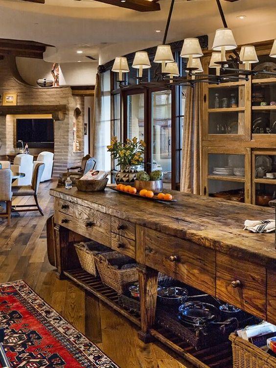 kitchen, wooden floor, wooden glass cabinet, wooden island with shelves below, chandelier