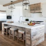 Kitchen, Wooden Floor, Wooden Island With Whtie Top, White Cabinet, White Kitchen Top, White Wall, White Ceiling, Clear Glass Pendant