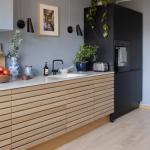 Kitchen, Wooden Floor, Wooden Slats Bottom Cabinet, Glight Grey Wall, Black Pantry, White Upper Cabinet, White Top, Black Sconces