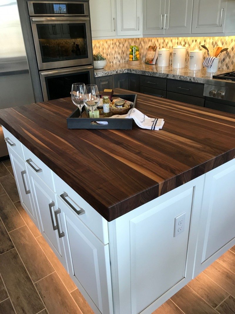 kitchen, wooden tiles, black bottom cabinet, white upper cabinet, backsplash tiles, white wooden island with wooden top, LED lights under the island