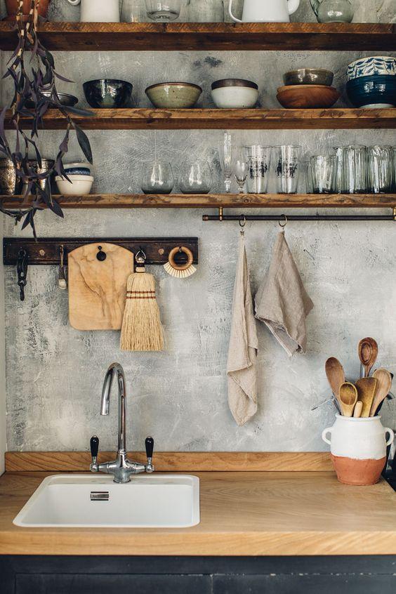 kitchen, wooden top, black bottom cabinet, white sink, grey wall, wooden floating shelves