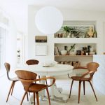 Lean Wooden Chairs, White Round Table, White Floor, White Wall, White Ceiling