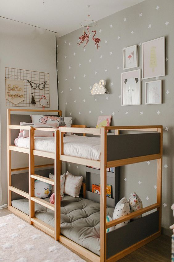 light and sturdy wooden bunkbed wth grey board, grey wall, white wall, wooden floor, rug, wall decoration