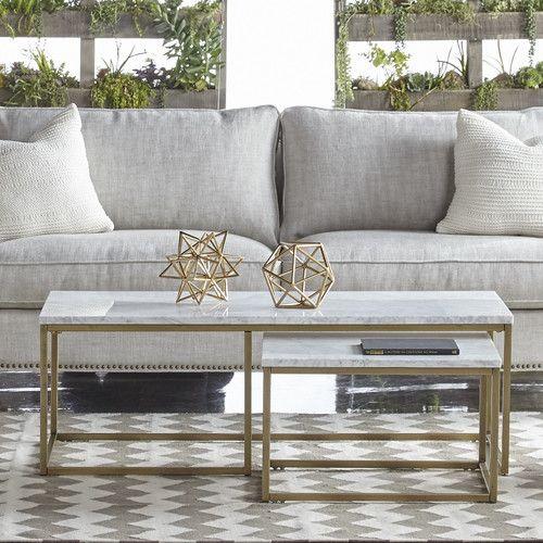 living room, black floor, marble rectangular nesting table, grey sofa, pillows
