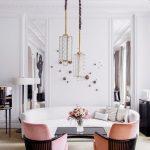 Long Geometric Glass Pendant, White Wall, Brown Rug, Pink Chairs, Black Coffee Table, White Curvy Sofa, White Floor Lamp
