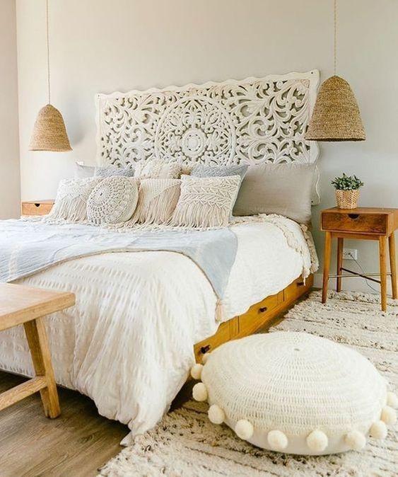 long rope pendant for reading lamp beside wooden bed platform, white headboard, wooden floor, white ottoman, white rug, wooden side table