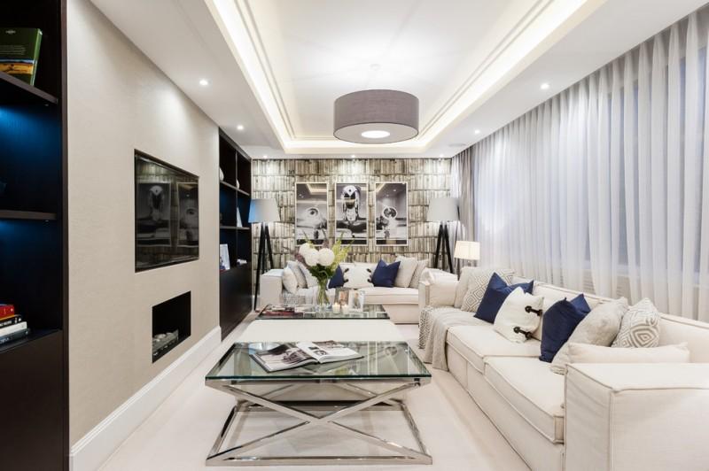 luxurious living room white sofas pillows pendant lamp glass coffee table fireplace white curtain artwork floor lamps table lamp black shelves