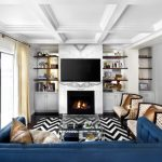 Modern Blue Couch Black And White Chevron Rug Luxurious Armchairs Glass Coffee Table White Marble Wall Fireplace Open Shelves Cabinet Beige Curtains Sliding Glass Door