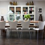 Modern Dining Sets With Bench Big Glass Bottles Wooden Floor Tile Modern White Chairs White Book Shelves Wooden Dining Table Glass Door Beige Curtain White Artwork