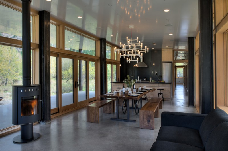 modern dining sets with bench chandelier fireplace island black stools wooden table iron base wooden benches black sofa glass doors glass windows