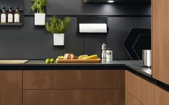 modern kitchen, beige floor, dark wooden cabinet, black marble countertop, black smooth backsplash with rail
