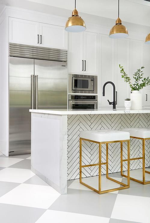 modern kitchen, white grey plaid floor tiles, white marble island top, white herringbone patern under the top, white pantry cabinet, golden pendants