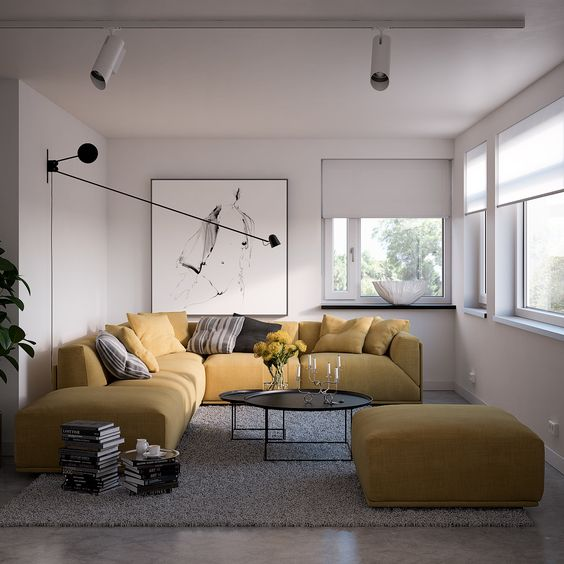 modern living room, marble floor, grey rug, yellow fluffy sofa and ottoman, black round coffee table, white wall, white shade, ceiling lamp, pendant lamp