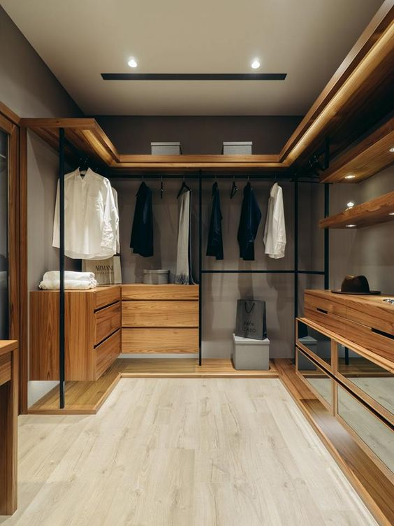 modern walkign closet with wooden floating cabinet, rails, drawers, wooden floor