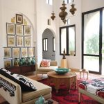 Moroccan Styled Chandelier, White Wall, White Sofa, Red Rug, Moroccan Detailed Coffee Table, Arch Wall, Glass Door