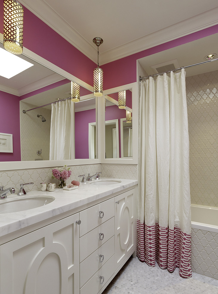 nice shower curtains pink fabric beige mosaic shower wall tile glass pendant lamps pink walls white vanity white sink white marble top built in tub wide wall mirror backsplash