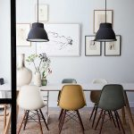 Nude Colored Mid Century Chairs, White Table, White Wall, Black Pendants, Brown Rug, Grey Floor