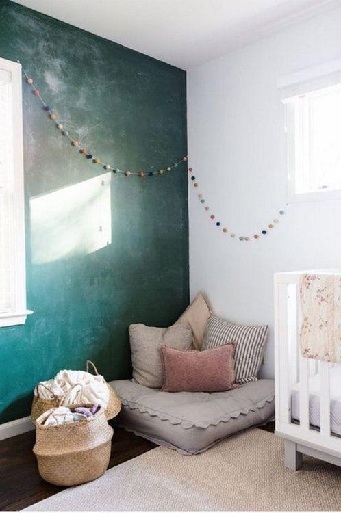 nursery, wooden floor, rattan basket, green wall, white wall, white wooden crib