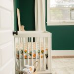 Nursery, Wooden Floor, Rug, White Crib, Dark Green Wall, White Wooden Framed Window, White Curtain