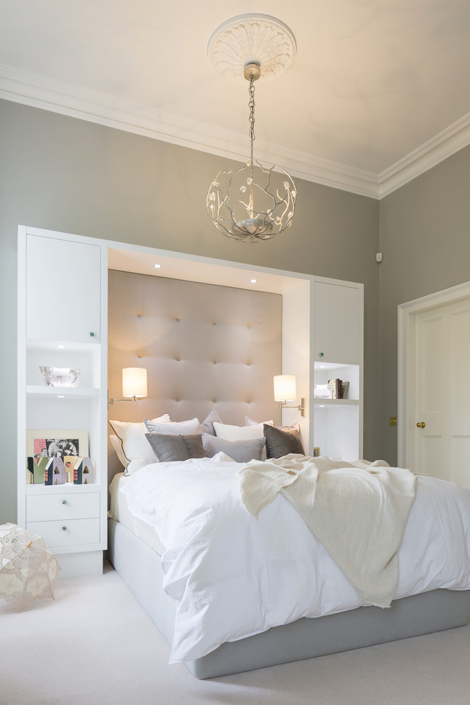 over bed lighting gray walls white built in cabinet gray tufted headoard pull out sconces white bedding blossom chandelier pillows drawers