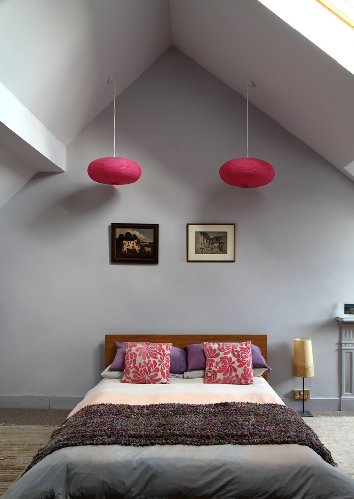 over bed lighting red pendant lamps gray wall vaulted ceiling colorful pillows bedding small floor lamp wooden headboard frames