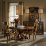 Pedestal Dining Table With Leaf Table Lamps Chandelier Area Rug Wooden Console Windows Beige Curtain Tan Walls Wooden Chairs