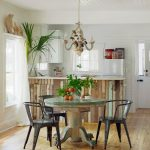 Pedestal Dining Table With Leaf Wooden Floor White Top White Cabinet White Window White Curtain Chandelier Refrigerator
