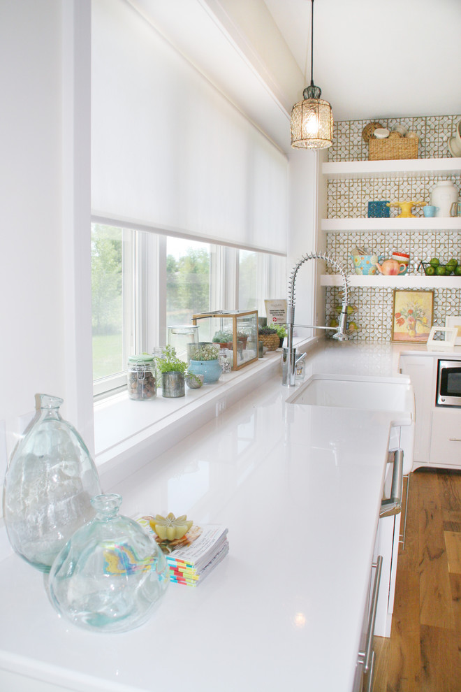 privacy window treatment white window blinds white countertop white wooden open shelves glass windows pull out faucet wooden floor oven