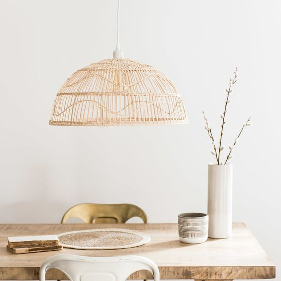 rattan pendant, wooden table, white and golden metal chairs, white wall