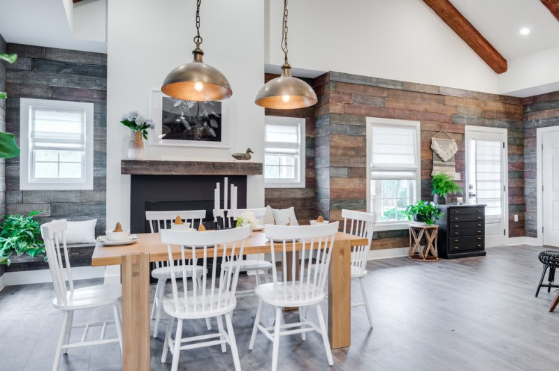 rustic dining table industrial pendant lamps white chairs black fireplace windows shades mantel beams
