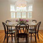 Rustic Dining Table White Chandelier White Windows Wooden Pedestal Table Dark Brown Chairs Wooden Floor Shutter