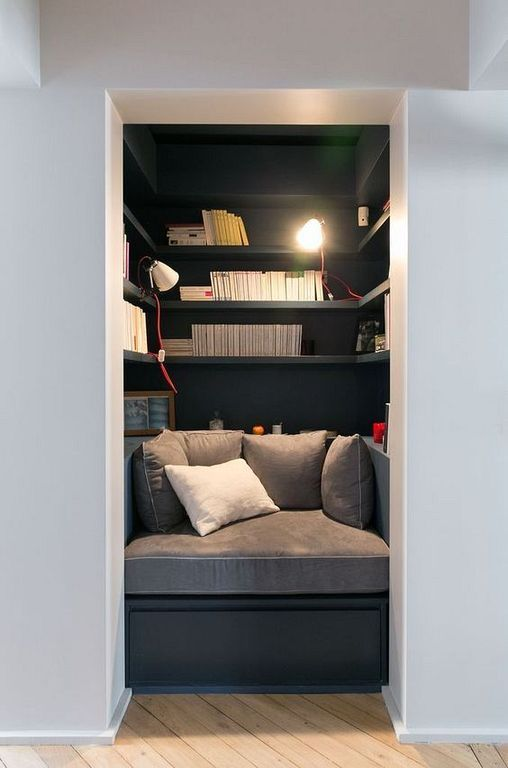 small alcove, black bench with grey seating, black built in shelves