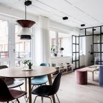 Small Apartment, Light Wooden Floor, Blue Sofa, Bedroom With Glass Partition, Shelves, Wooden Round Dining Table With Modern Chairs, Pendant