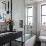 Small Bathroom Black Open Vanity Sink Faucet Wall Mirror Wall Sconces Toilet Windows Glass Shower Door Built In Tub Built In Shelves Black Floor Tile