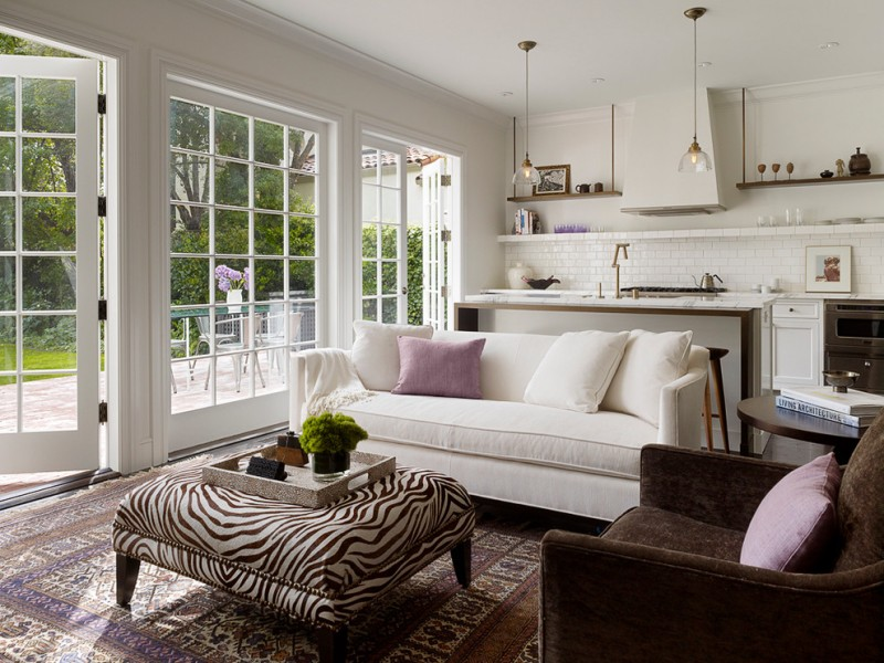 small living room design ideas white sofa zebra ottoman mediterranean rug glass windows frech door pillows ray brown armchair pendant lamps