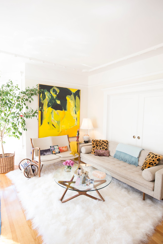 small living room design ideas white walls white shag rug star coffee table gray sofa big yellow and black artwork pillows bench chair side table white table lamp