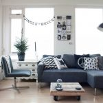 Small Living Room Ideas Pinterest Dark Blue Sectional Couch Floor Lamp Windows Shades Blue Chair Wheeled Coffee Table Drawers Shelves